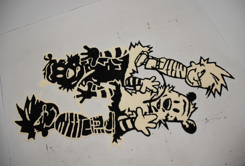 moscarella-enzo_calvin-and-hobbes-ephemeral-floor-drawing-dried-long-grain-white-rice-and-dried-black-beans-2013